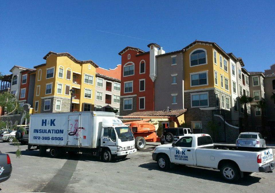 Installing fiberglass insulation in a multifamily building in Dallas Texas,